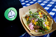 Banzo's Beer Braised Lamb on a chickpea tortilla with smoked cauliflower puree, pickled onion, mango salsa, chug and cilantro, during the 4th annual Yum Yum Fest held at Breese Stevens Field, Sunday, August 6, 2017.