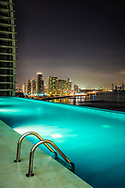 Infinity pool and night view of Panama city's skyline, Panama.