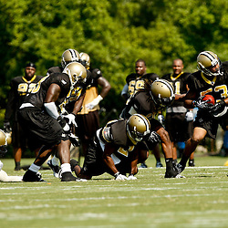 August 1, 2010; Metairie, LA, USA; New Orleans Saints linebacker Stanley Arnoux (53) picks up a fumble by running back Chris Ivory (48) during a training camp practice at the New Orleans Saints practice facility. Mandatory Credit: Derick E. Hingle