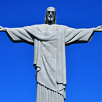 Christ the Redeemer on Corcovado Mountain in Rio de Janeiro, Brazil<br /> Without question, Rio de Janeiro's most famous image is the Christ the Redeemer statue on Corcovado mountain. This figure's outstretched arms – measuring 92 feet wide - symbolize peace. The Jesus Christ figure was made from sandstone and concrete in 1931 by sculptor Paul Landowski. The world's tallest Art Deco statue stands 124 feet. Nearly every visitor to Rio travels through the forest of Tijuca National Park for a close up and a photo. Yet this icon of Brazil can be seen from almost anywhere in the city. Not surprising, Cristo Redentor was voted as one of the New Seven Wonders of the World in 2007.