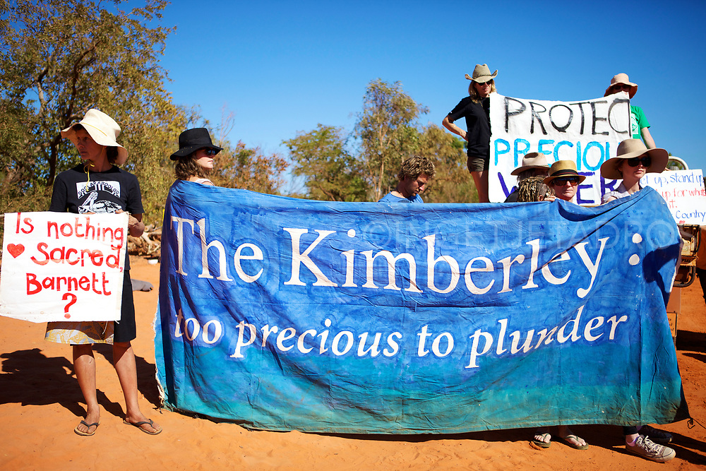 Dozens of protesters, protesting with banners to halt work on Woodside's gas factory project near James Price Point. Broome, WA