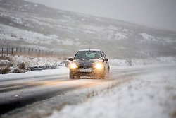 © Licensed to London News Pictures. 08/12/2017. Llanberis UK. Vehicle's travel through the snow this morning in Capel Curing in in the Snowdon national park. Photo credit: Andrew McCaren/LNP