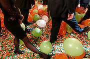 Attendees of the California Republican Party's election night celebration kick balloons after the acceptance speech of California Governor Arnold Schwarzenegger in Beverly Hills, CA, November 7, 2006.  Schwarzenegger's re-election was a point of revelry for the Republican crowd after a night of sweeping upsets for the party in the day's midterm elections.