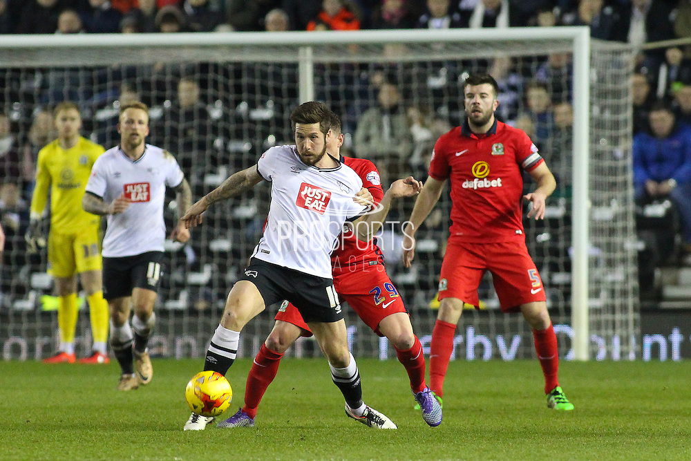 Derby County midfielder Jacob Butterfield under pressure from Blackburn Rovers midfielder Corry Evans during the Sky Bet Championship match between Derby County and Blackburn Rovers at the iPro Stadium, Derby, England on 24 February 2016. Photo by Aaron  Lupton.