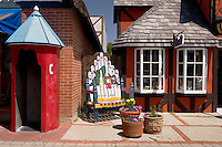 Colorful Telephone Booth, Wooden Chair, Flower Pots and Danish Half-Timbered House Windows, Solvang, California