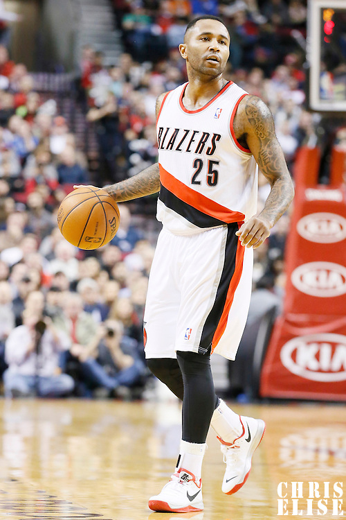 04 December 2013: Portland Trail Blazers point guard Mo Williams (25) brings the ball upcourt during the Portland Trail Blazers 111-104 victory over the Oklahoma City Thunder at the Moda Center, Portland, Oregon, USA.