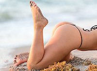 Woman's beautiful butt and legs on the beach