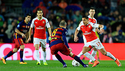 Arsenal's Alexis Sanchez takes on Andres Iniesta of Barcelona  - Mandatory byline: Matt McNulty/JMP - 16/03/2016 - FOOTBALL - Nou Camp - Barcelona,  - FC Barcelona v Arsenal - Champions League - Round of 16