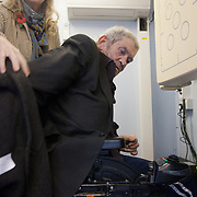 Radiographer Jane helps Seamus out of his coat and help him settle in to have his chest x-rayed. The NHS Mobile X-ray Unit visiting St Pauls Church drop-in  in Onslow Square, London SW7. The rates of tuberculosis in London are higher than any other Western European capital and is a major health problem. Tuberculosis is highly contagious, it is treatable, but in the event of no treatment it is often deadly. The MXU, the Mobile X-ray Unit, is a facility run by the NHS. The MXU is a Tuberculosis screening service on wheels where people can have their chest x-rayed and within minutes be either cleared of TB - or in case of any TB symptoms showing up on the X-rays, be referred to a hospital for further tests and possible treatment. The MXU is aimed at hard to reach groups like homeless people, drug or alcohol abuser and prisoners. The van is the only one in the UK and operates around London where it visits hostels, prisons and community centres where groups of hard to reach clients usually gather. On the van is a team of nurses, radiographers, social and outreach workers and expert technicians..The MXU van is a part of the NHS department Find and Treat.