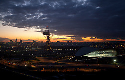 © Licensed to London News Pictures . 01/03/2014. London, UK.  A sunset view of the ArcelorMittal Orbit and the London Aquatics Centre, which has opened to the public today. During the Olympic Games 2012, London largest  pool was the backdrop to gold achievement of Team GB diver Tom Daley. (01/03/14)  Photo credit: Isabel Infantes /LNP