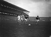 Galway and Cork players close in on the ball hoping to gain possession during the All Ireland Senior Gaelic Football Championship Final, Cork v Galway in Croke Park on the 7th October 1956. Galway 2-13 Cork 3-7.