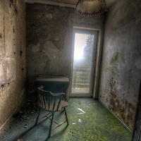 Old very moldy hotel. Hotel Schimmelig interior with chair