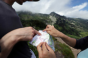 card reading and looking for directions during a hike in the mountains