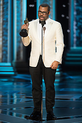 March 4, 2018 - Hollywood, California, U.S. - Jordan Peele accepts the Oscar for Original Screenplay for work on Get Out during the live ABC Telecast of The 90th Oscars at the Dolby Theatre in Hollywood. (Credit Image: ? Aaron Poole/AMPAS via ZUMA Wire/ZUMAPRESS.com)