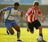 Photo: Frances Leader.<br />Brentford v Swindon Town. Coca Cola League 1.<br />15/10/2005.<br /><br />Brentford's Jay Tabb and Swindons Jerel Ifil at the ball.