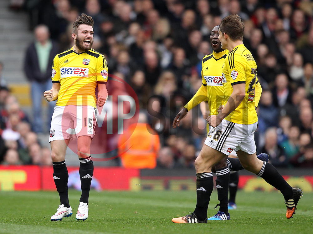 Brentford's Stuart Dallas celebrates with Brentford's Toumani Diagouraga and Brentford's James Tarkowski - Photo mandatory by-line: Robbie Stephenson/JMP - Mobile: 07966 386802 - 03/04/2015 - SPORT - Football - Fulham - Craven Cottage - Fulham v Brentford - Sky Bet Championship