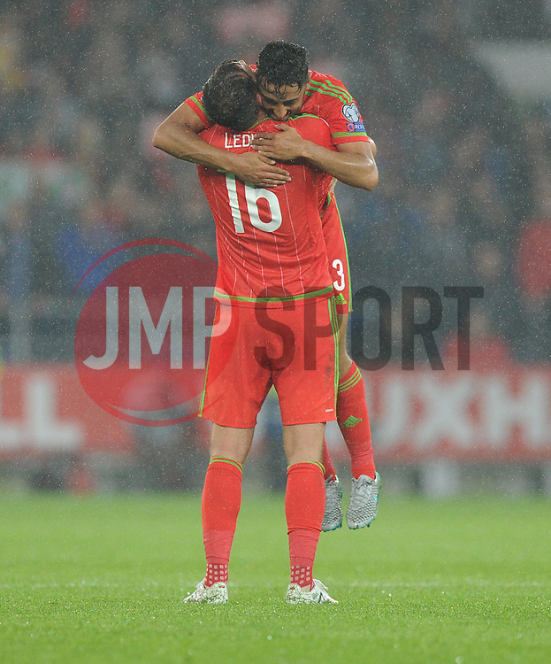 Joe Ledley of Wales (Crystal Palace) celebrates with Neil Taylor of Wales (Swansea City) at full time. - Photo mandatory by-line: Alex James/JMP - Mobile: 07966 386802 - 12/06/2015 - SPORT - Football - Cardiff - Cardiff City Stadium - Wales v Belgium - Euro 2016 qualifier