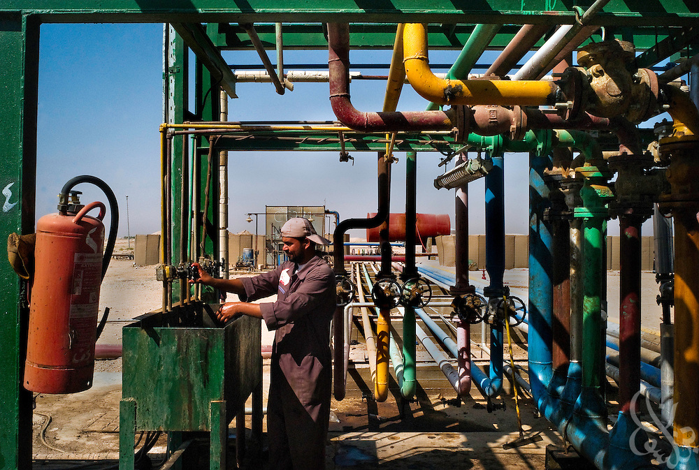 Workers conduct routine maintenance at a small scale Central Oil Company refinery facility on the outskirts of an-Najaf in Southern Iraq September 19, 2007. The facility currently refines 10,000 barrels per day, with an eventual planned capacity of 30,000 expected over the next year or so after improvements are made and new equipment brought in. According to the Najaf regional governor, the refinery improvements are part of a broader effort to achieve provincial self sufficiency over the next few years.