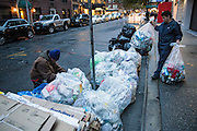 "17 November 2013 - New York, NY [Austin ""Guy"" Butler sorts through recycling as a maintenance man carries out more bags.] 11/17/13 Stoneham/CUNY Journalism Photo"