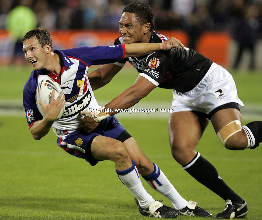 Danny McGuire tries to fend off Manu Vatuvei during the Gillette Tri Nations rugby league match between the New Zealand Kiwis and Great Britain at Jade Stadium, Christchurch, New Zealand on Saturday 28 October, 2006. The Kiwis won the match 18 - 14. Photo: Hannah Johnston/PHOTOSPORT<br /> <br /> <br /> <br /> 281006