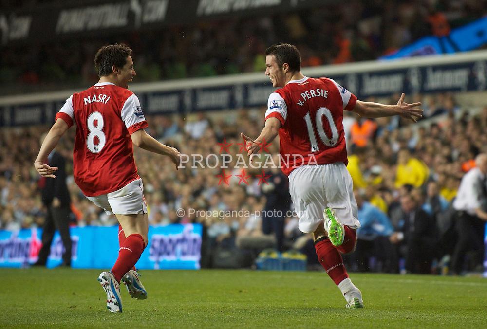 LONDON, ENGLAND - Wednesday, April 20, 2011: Arsenal's Robin Van Persie celebrates scoring the third goal against Tottenham Hotspur during the Premiership match at White Hart Lane. (Photo by David Rawcliffe/Propaganda)