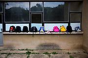 Children's backpacks at Serbian School, during a KFOR unveiling of a new bridge...Banska, Kosovo, Serbia..