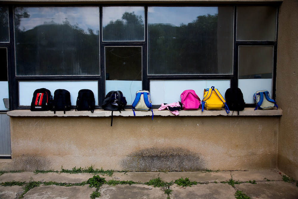 Children's backpacks at Serbian School, during a KFOR unveiling of a new bridge...Banska, Kosovo, Serbia..