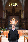 Father Michael Pfleger poses for a portrait inside St. Sabina.