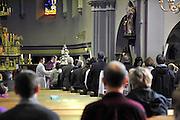 Nederland,Nuth, 25-3-2012Polen tijdens de heilige mis in de St. Bavo kerk.De viering is in het Pools en wordt geleidt door een Poolse pastoor.In Zuid Limburg wonen al honderd jaar polen die in de mijnen werkten om steenkool te delven.Foto: Flip Franssen