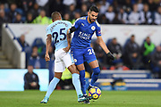 Leicester City midfielder Riyad Mahrez (26) battles with Manchester City midfielder Fernandinho (25) during the Premier League match between Leicester City and Manchester City at the King Power Stadium, Leicester, England on 18 November 2017. Photo by Jon Hobley.