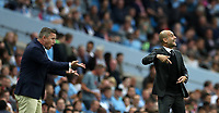 Football - 2016 / 2017 Champions League - Qualifying Play-Off, Second Leg: Manchester City [5] vs. Steaua Bucharest [0]<br /> <br /> Pep Guardiola Manager of Manchester City and Laurentiu Reghecampf of Steaua Bucharest  during the match, at the Ethihad Stadium.<br /> <br /> COLORSPORT/LYNNE CAMERON