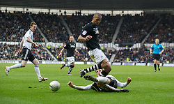 DERBY, ENGLAND - Saturday, March 12, 2011: Swansea City's Darren Pratley is tackled by Derby County's Daniel Ayala during the Football League Championship match at Pride Park. (Photo by David Rawcliffe/Propaganda)