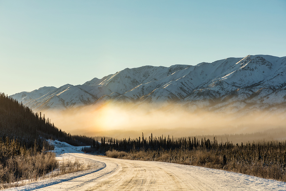 Icebow created by blowing snow in the Yukon Territory. Winter. Morning.