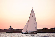 Vindex sailing in the Herreshoff S Class division of the Newport Yacht Club Tuesday night racing series. Rose Island Lighthouse in the background.