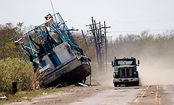 08 Sept 2005.  New Orleans, Louisiana. Hurricane Katrina aftermath. <br /> Venetian Isles in East New Orleans, where the tidal surge washed over the land and devastated homes and property. A shrimp boat in East New Orleans, where the tidal surge washed over the land and devastated homes and property dumping ships on the Chef Menteur highway.<br /> Photo; ©Charlie Varley/varleypix.com