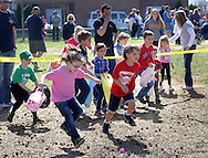 FAIRLESS HILLS, PA - APRIL 12:  Children dash off to find Easter eggs during the YMCA Easter Egg Hunt April 12, 2014 in Fairless Hills Pennsylvania. (Photo by William Thomas Cain/Cain Images)