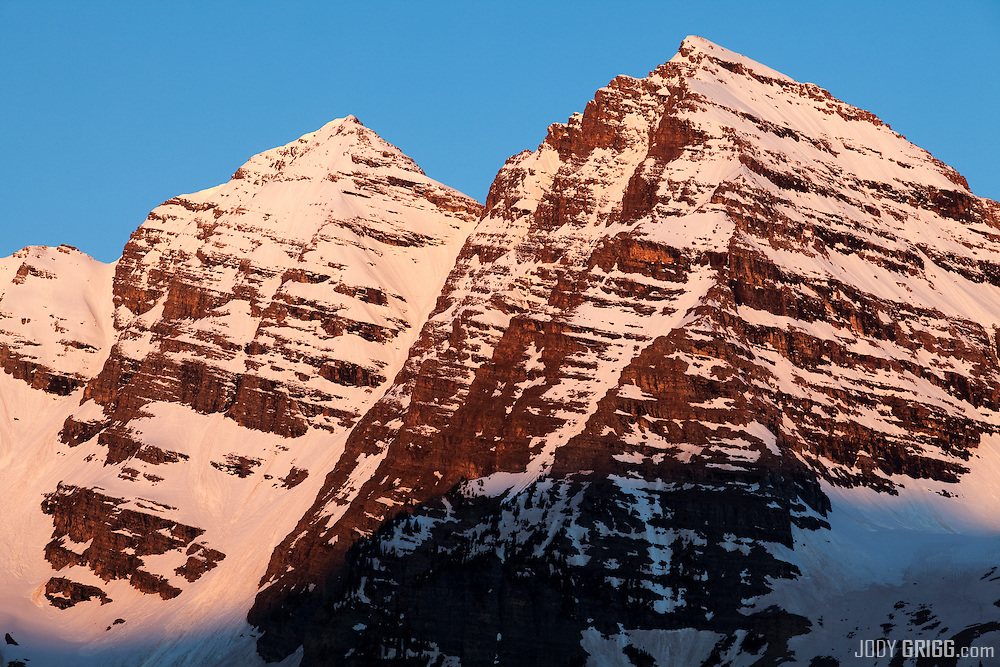Maroon Bells viewed at sunrise during the spring time, Elk Mountains, Colorado.