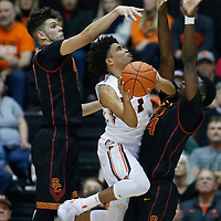 Oregon State's Stephen Thompson Jr., center, is double teamed by Southern California's Nick Rakocevic, left, and Chimezie Metu, right, during the second half of an NCAA college basketball game in Corvallis, Ore., Wednesday Dec. 28, 2016. Southern California won 70-63. (AP Photo/Timothy J. Gonzalez)