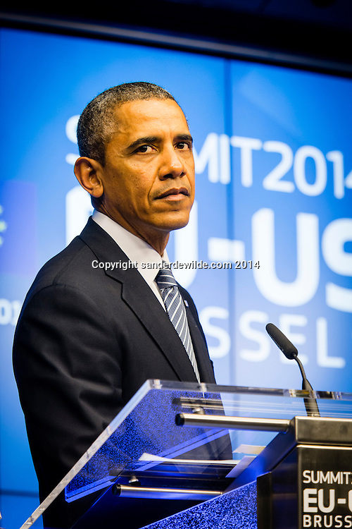 U.S. President Barack Obama  addresses the media at the European Council building in Brussels, on Wednesday, March 26, 2014.