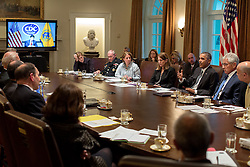 President Barack Obama meets with Cabinet members on the domestic response to Ebola, in the Cabinet Room of the White House, Oct.15, 2014. Dr. Tom Frieden, Director of the Centers for Disease Control and Prevention, participates via video teleconference. (Official White House Photo by Pete Souza)<br /> <br /> This official White House photograph is being made available only for publication by news organizations and/or for personal use printing by the subject(s) of the photograph. The photograph may not be manipulated in any way and may not be used in commercial or political materials, advertisements, emails, products, promotions that in any way suggests approval or endorsement of the President, the First Family, or the White House.