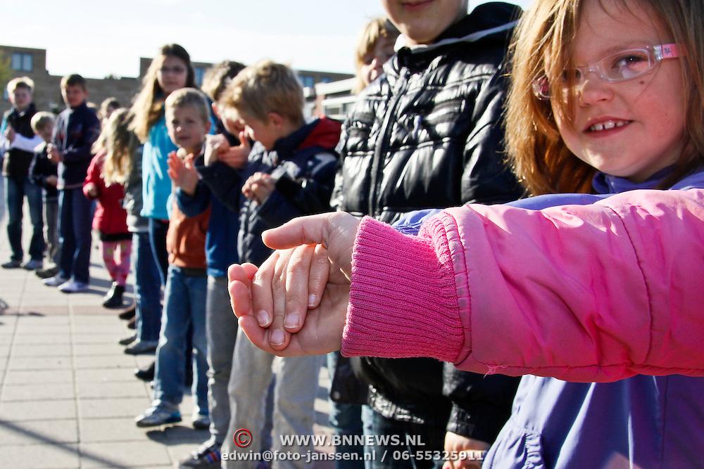 NLD/Huizen/20100421 - Springplank project Meten te Lijf slinger van leerlingen