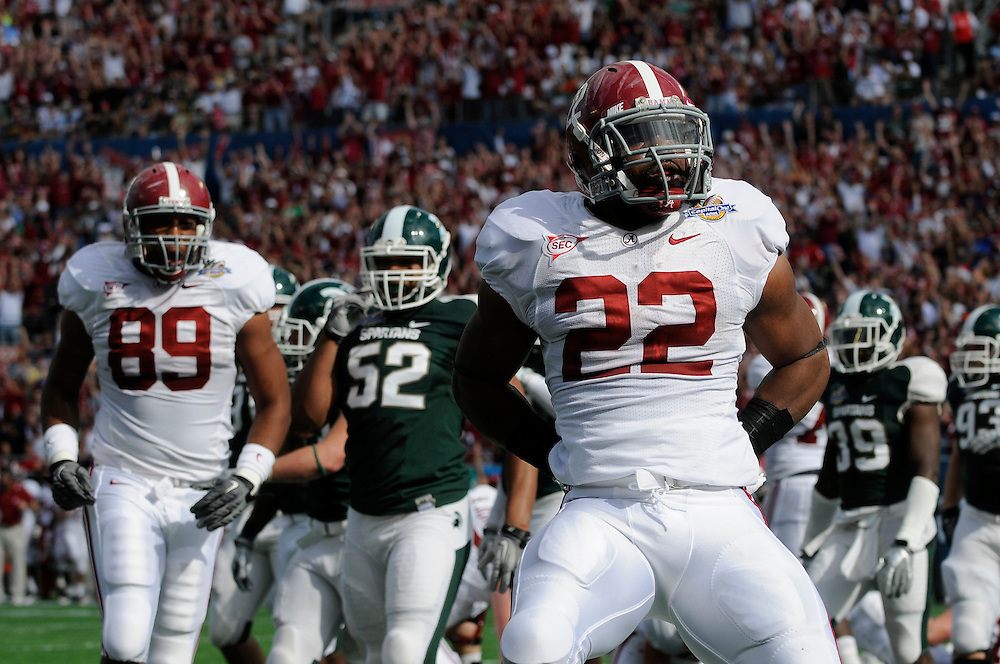 January 1, 2011: Mark Ingram of the Alabama Crimson Tide celebrates after scoring a touchdown during the NCAA football game between the Michigan State Spartans and the Alabama Crimson Tide at the 2011 Capital One Bowl in Orlando, Florida. Alabama led Michigan State 28-0 at the half.