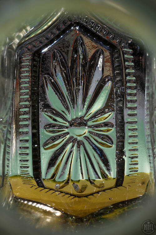 """Beauty at the Bottom: Tequila 22"" - This is a photograph of a tequila bottle, shot right down inside the mouth of the bottle."