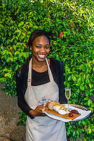 "A waitress holds a local cheese platter accompanied by Pierre Jordan Ratafia wine, the last of a six course ""Taste of Summer"" lunch menu, restaurant at Haute Cabriere Vineyard Estate, Franschhoek Pass, Franschhoek, Cape Winelands, South Africa."
