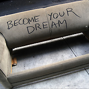 &quot;Become Your Dream&quot; Street Art.  What do you think the artist is saying by this statement? Furniture thrown out on the street .<br /> <br /> Street art can be a powerful platform for reaching people in public spaces. One persons garbage has become a others art.