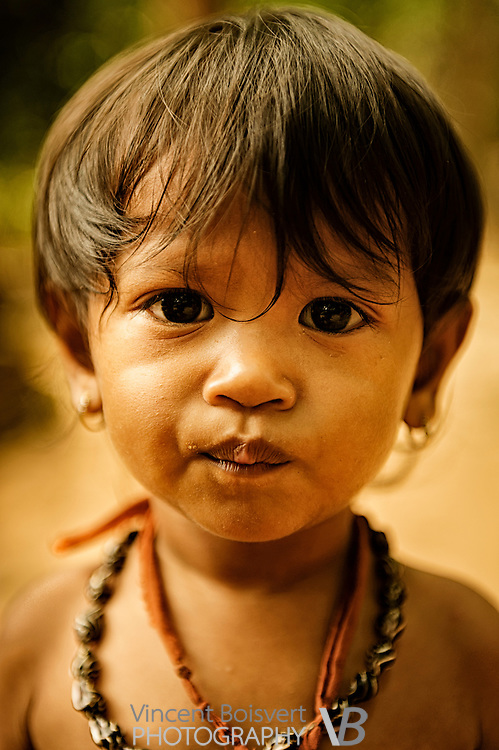 A close-up of a little cambodian girl, Ta Som Temple, Siem Reap, cambodia