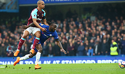 April 8, 2018 - London, England, United Kingdom - L-R West Ham United's  Joao Mario  and Chelsea's Victor Moses.during English Premier League match between Chelsea and West Ham United at Stamford Bridge, London, England on 08 April 2018. (Credit Image: © Kieran Galvin/NurPhoto via ZUMA Press)