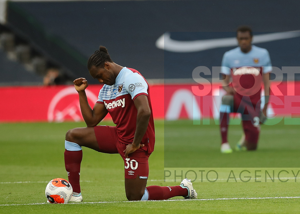 Michail Antonio of West Ham United takes a knee during the Premier League match at the Tottenham Hotspur Stadium, London. Picture date: 23rd June 2020. Picture credit should read: David Klein/Sportimage