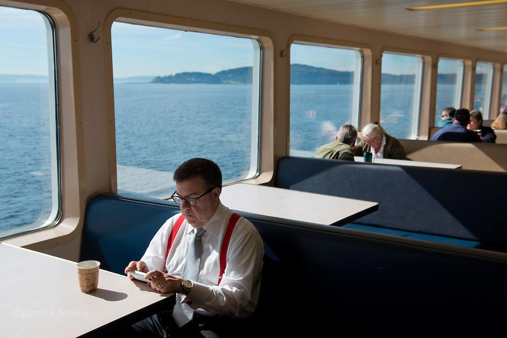 Work never rests. Bainbridge-Seattle ferry.