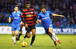 Peterborough United's Mark Little in action with Gillingham's Bradley Dack - Photo mandatory by-line: Joe Dent/JMP - Tel: Mobile: 07966 386802 14/12/2013 - SPORT - Football - Gillingham - Priestfield Stadium - Gillingham v Peterborough United - Sky Bet League One